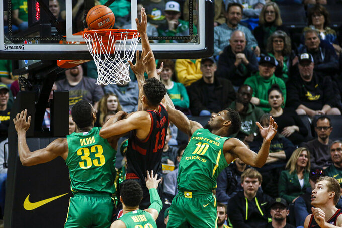 Stanford forward Oscar da Silva (13) scores against Oregon during the first half of an NCAA college basketball game in Eugene, Ore., Saturday, March 7, 2020. (AP Photo/Thomas Boyd)