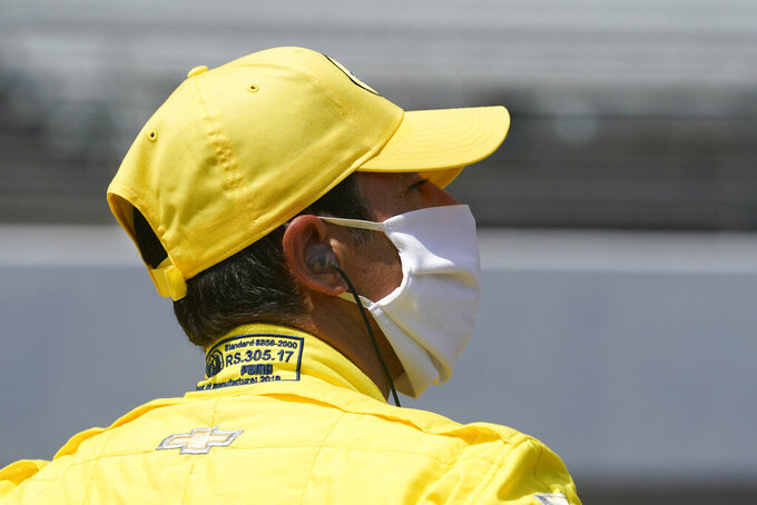 Helio Castroneves, of Brazil, watches during qualifications for the Indianapolis 500 auto race at Indianapolis Motor Speedway, Saturday, Aug. 15, 2020, in Indianapolis. (AP Photo/Darron Cummings)