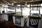Food stalls are covered and empty in the concourse as the Washington Nationals hold their first training camp work out at Nationals Stadium, Friday, July 3, 2020, in Washington. (AP Photo/Andrew Harnik)