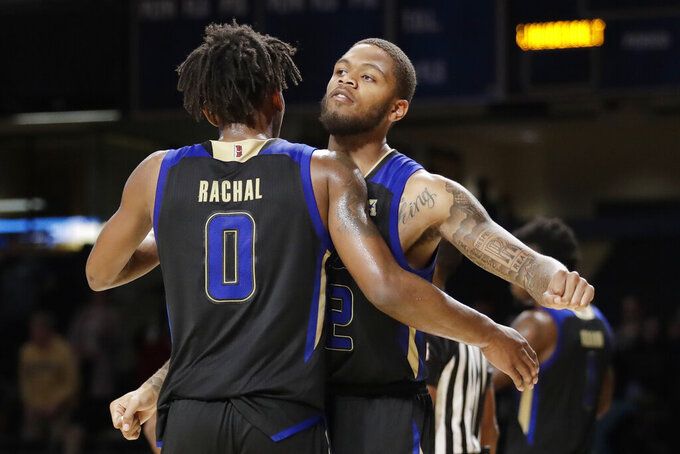 Tulsa's Brandon Rachal (0) and Reggie Jones celebrate the team's 67-58 win over Vanderbilt in an NCAA college basketball game Saturday, Nov. 30, 2019, in Nashville, Tenn. (AP Photo/Mark Humphrey)