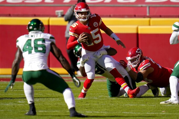 New York Jets' Neville Hewitt (46) looks on as defensive tackle Quinnen Williams, rear, wraps up Kansas City Chiefs quarterback Patrick Mahomes (15) in the first half of an NFL football game on Sunday, Nov. 1, 2020, in Kansas City, Mo. (AP Photo/Jeff Roberson)