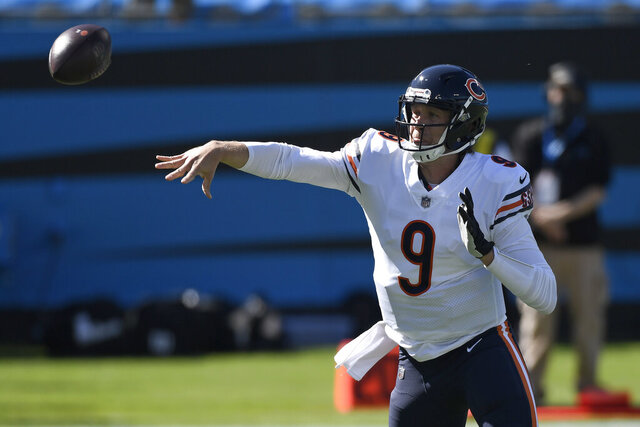 Chicago Bears quarterback Nick Foles (9) passes against the Carolina Panthers during the first half of an NFL football game in Charlotte, N.C., Sunday, Oct. 18, 2020. (AP Photo/Mike McCarn)