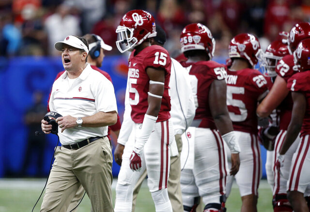FILE - In this Jan. 2, 2017, file photo, Oklahoma coach Bob Stoops calls out from the sideline during the second half of the team's Sugar Bowl NCAA college football game against Auburn in New Orleans. Stoops is helping coach the Sooners again because of coronavirus issues. The Sooners had last Saturday's game at West Virginia postponed, and they temporarily paused organized team activities due to positive COVID-19 tests and contact tracing throughout the program. The situation affected the assistant coaching ranks, leading Oklahoma coach Lincoln Riley to ask Stoops for help. (AP Photo/Gerald Herbert, File)