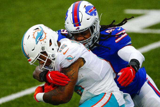 Miami Dolphins wide receiver Lynn Bowden (15) is tackled by Buffalo Bills middle linebacker Tremaine Edmunds (49) in the first half of an NFL football game, Sunday, Jan. 3, 2021, in Orchard Park, N.Y. (AP Photo/John Munson)
