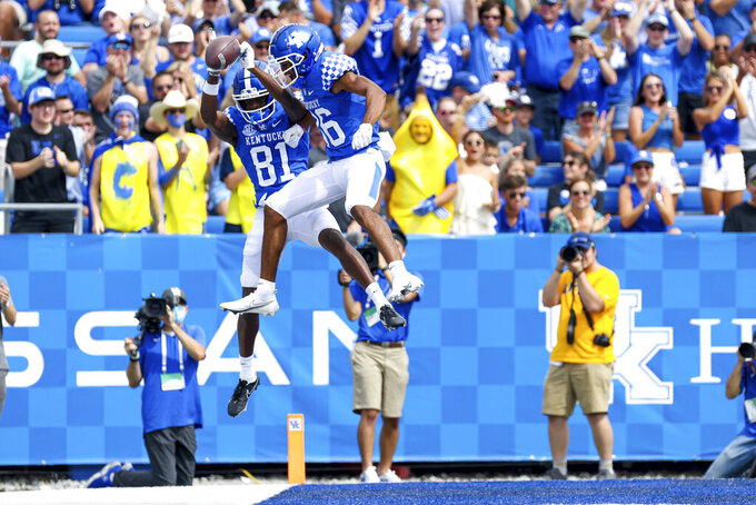 Kentucky wide receiver Isaiah Epps (81) celebrates scoring a touchdown wide receiver DeMarcus Harris (86) during the first half of a NCAA college football game against Chattanooga in Lexington, Ky., Saturday, Sept. 18, 2021. (AP Photo/Michael Clubb)