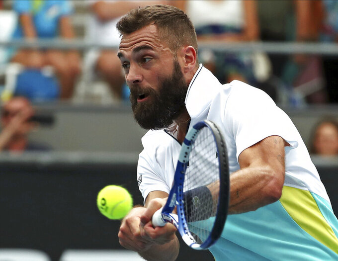 FILE - In this Wednesday, Jan. 22, 2020 file photo, France's Benoit Paire makes a backhand return to Croatia's Marin Cilic during their second round singles match at the Australian Open tennis championship in Melbourne, Australia. Paire has tested positive for the coronavirus and was removed from the U.S. Open field, a person familiar with the situation told The Associated Press on Sunday, Aug. 30, 2020. (AP Photo/Dita Alangkara)