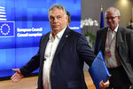 """FILE - In this Saturday, July 18, 2020, file photo, Hungary's Prime Minister Viktor Orban gestures at an EU summit in Brussels. Hungary's prime minister says that his country won a """"very important battle"""" at the European Union summit this week, where national leaders of the 27-member bloc decided an seven-year budget and economic recovery package to counter the effects of the coronavirus pandemic. (John Thys, Pool Photo via AP, File)"""