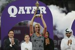 Belgium's Elise Mertens holds her trophy after she defeated Romania's Simona Halep in a final match of the the Qatar Open tennis tournament in Doha, Qatar, Saturday, Feb. 16, 2019. (AP Photo/Kamran Jebreili)
