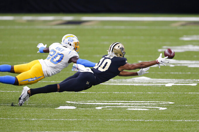 New Orleans Saints wide receiver Tre'Quan Smith (10)dives in vain for a pass as Los Angeles Chargers free safety Desmond King (20) covers in the first half of an NFL football game in New Orleans, Monday, Oct. 12, 2020. (AP Photo/Brett Duke)