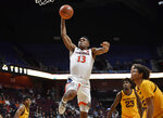 Virginia's Casey Morsell goes up for a dunk as Virginia players watch during the first half of an NCAA college basketball game, Sunday, Nov. 24, 2019, in Uncasville, Conn. (AP Photo/Jessica Hill)