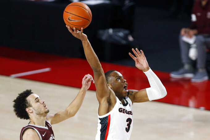 Georgia's Christian Brown (3) goes up to dunk against Montana during an NCAA college basketball game Tuesday, Dec. 8, 2020, in Athens, Ga. (Joshua L. Jones/Athens Banner-Herald via AP)
