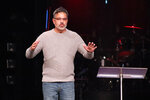 "Co-founder Mark DeYmaz speaks at the Mosaix Global Network's Multiethnic Church Conference on Nov. 5, 2019, in Keller, Texas. DeYmaz said the discussions at the conference, which now brings together more than 1,300 pastors, denominational leaders and researchers every three years, always demonstrate to him the contradictory reality of trying to unite black, white and other church traditions under one roof. ""The way you get comfortable in a healthy multiethnic church is to realize that you go, 'Man, I'm uncomfortable here,'"" he said in an interview in early January. (Adelle M. Banks/RNS via AP)"