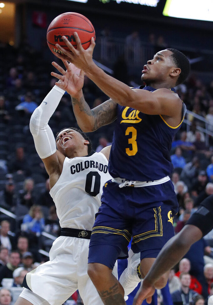 California's Paris Austin shoots over Colorado's Shane Gatling during the second half of an NCAA college basketball game in the first round of the Pac-12 men's tournament Wednesday, March 13, 2019, in Las Vegas. (AP Photo/John Locher)
