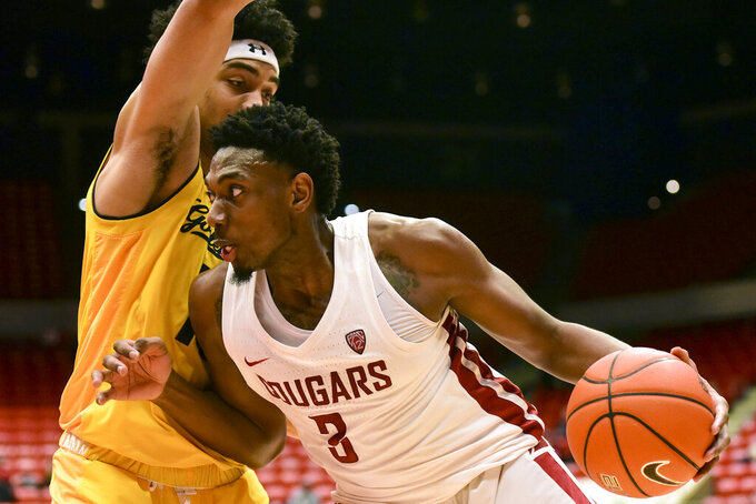Washington State forward Robert Franks (3) drives to the basket as California forward Justice Sueing (10) defends during the second half of an NCAA college basketball game Thursday, Jan. 17, 2019, in Pullman, Wash. Washington State won 82-59. (Pete Caster/The Lewiston Tribune via AP)