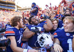 Auburn defensive lineman Andrew Williams (79) reacts with teammates following an NCAA college football game against Texas A&M, Saturday, Nov. 3, 2018, in Auburn, Ala. (AP Photo/Todd Kirkland)
