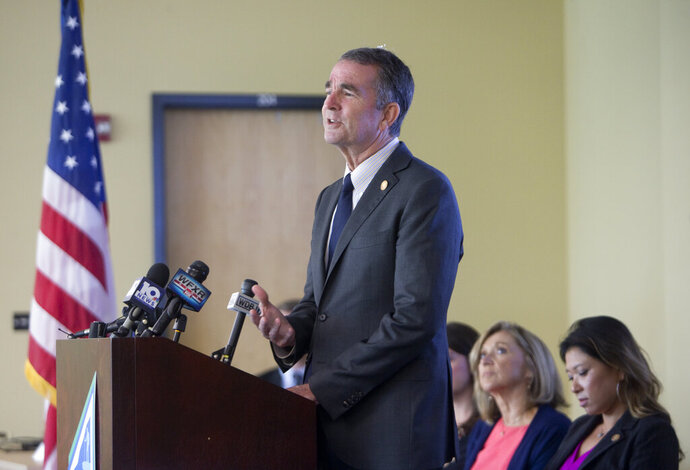 Governor Ralph Northam was in Roanoke County on Monday to join others to announce an expansion to the Roanoke Valley of the Virginia's Framework Addiction Analysis and Community Transformation (FAACT), data sharing platform that will aid in the opioid crisis fight. (l)Nancy Hans, Exec.Dir. Prevention Council of Roanoke County and Deputy Secretary of Public Safety, Jae K. Davenport. Photo taken August 26. (Stephanie Klein-Davis/The Roanoke Times via AP)