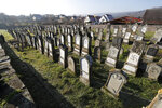 Vandalized tombs are pictured in the Jewish cemetery of Westhoffen, west of the city of Strasbourg, eastern France, Wednesday, Dec. 4, 2019. Regional authorities in eastern France say vandals have scrawled anti-Semitic inscriptions, including swastikas spray-painted in black, on 107 tombs in a Jewish cemetery. (AP Photo/Jean-Francois Badias)