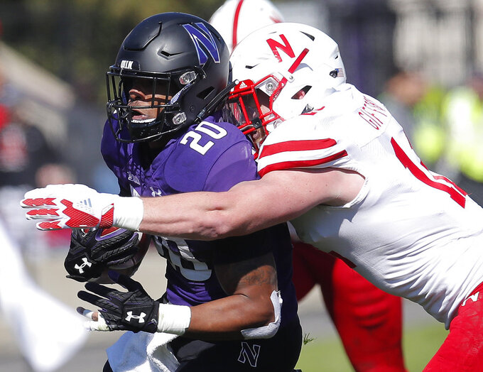 Northwestern's John Moten IV, left, is tackled by Nebraska's Luke Gifford during the first half of an NCAA college football game Saturday, Oct. 13, 2018, in Evanston, Ill.. (AP Photo/Jim Young)