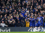 Chelsea's Christian Pulisic celebrates with teammates after scoring his sides second goal during their English Premier League soccer match between Chelsea and Crystal Palace at Stamford Bridge stadium in London, Saturday, Nov. 9, 2019. (AP Photo/Alastair Grant)