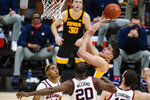 FILE - Iowa center Luka Garza shoots against Illinois in the first half of an NCAA college basketball game at the Big Ten Conference tournament in Indianapolis, in this Saturday, March 13, 2021, file photo. Garza was named The Associated Press men's basketball player of the year on Thursday, April 1. (AP Photo/Michael Conroy, File)