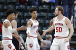 Indiana's Joey Brunk (50) is congratulated by Justin Smith (3) and Trayce Jackson-Davis (4) after Brunk made a shot and was fouled during the first half of an NCAA college basketball game against Notre Dame, Saturday, Dec. 21, 2019. (AP Photo/Darron Cummings)