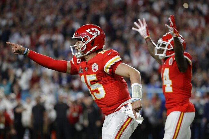 Kansas City Chiefs quarterback Patrick Mahomes (15) celebrates a play the San Francisco 49ers during the first half of the NFL Super Bowl 54 football game Sunday, Feb. 2, 2020, in Miami Gardens, Fla. (AP Photo/Patrick Semansky)