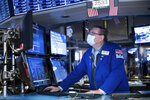 Specialist Patrick King works at the New York Stock Exchange on Monday, Nov. 23, 2020. Stocks rose in early trading Monday after investors received several pieces of encouraging news on COVID-19 vaccines and treatments, tempering concerns over rising virus cases and business restrictions.  (Nicole Pereira/New York Stock Exchange via AP)