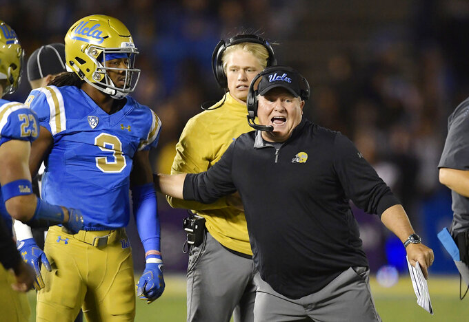 UCLA head coach Chip Kelly, right, tries to get defensive back Rayshad Williams into the game during the second half of an NCAA college football game against Arizona Saturday, Oct. 20, 2018, in Pasadena, Calif. UCLA won 31-30. (AP Photo/Mark J. Terrill)