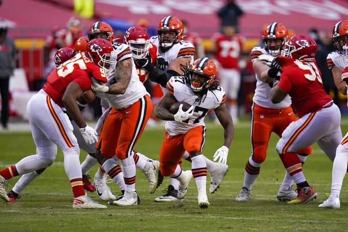Cleveland Browns running back Kareem Hunt (27) carries the ball up field during the second half of an NFL divisional round football game against the Kansas City Chiefs, Sunday, Jan. 17, 2021, in Kansas City. (AP Photo/Jeff Roberson)