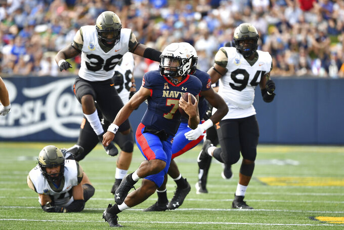 Navy quarterback Xavier Arline (7) runs the ball during the first half of an NCAA college football game against Air Force, Saturday, Sept. 11, 2021, in Annapolis, Md. (AP Photo/Terrance Williams)
