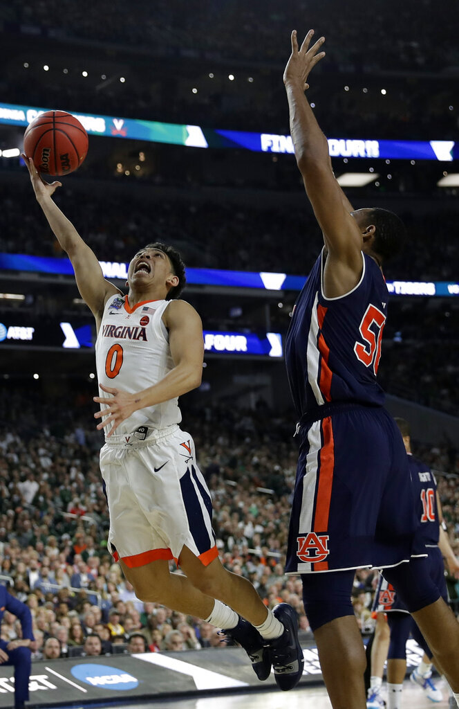 Virginia's Kihei Clark (0) shoots over Auburn's Austin Wiley (50) during the second half in the semifinals of the Final Four NCAA college basketball tournament, Saturday, April 6, 2019, in Minneapolis. (AP Photo/David J. Phillip)