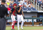 North Carolina State catcher Luca Tresh, left, talks with pitcher Dalton Feeney in the sixth inning during a baseball game against Vanderbilt in the College World Series, Friday, June 25, 2021, at TD Ameritrade Park in Omaha, Neb. (AP Photo/Rebecca S. Gratz)