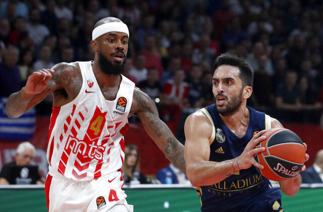 FILE 0- In this Nov. 7, 2019, file photo, Real Madrid's Facundo Campazzo, right, drives to the basket as Red Star's Lorenzo Brown blocks him during their Euroleague basketball match in Belgrade, Serbia. Campazzo made his training-camp debut with the Denver Nuggets on Sunday, Dec. 6, 2020, and the Nuggets are hoping that the flashy, diminutive guard adds a new toughness to their roster this season. (AP Photo/Darko Vojinovic, File)