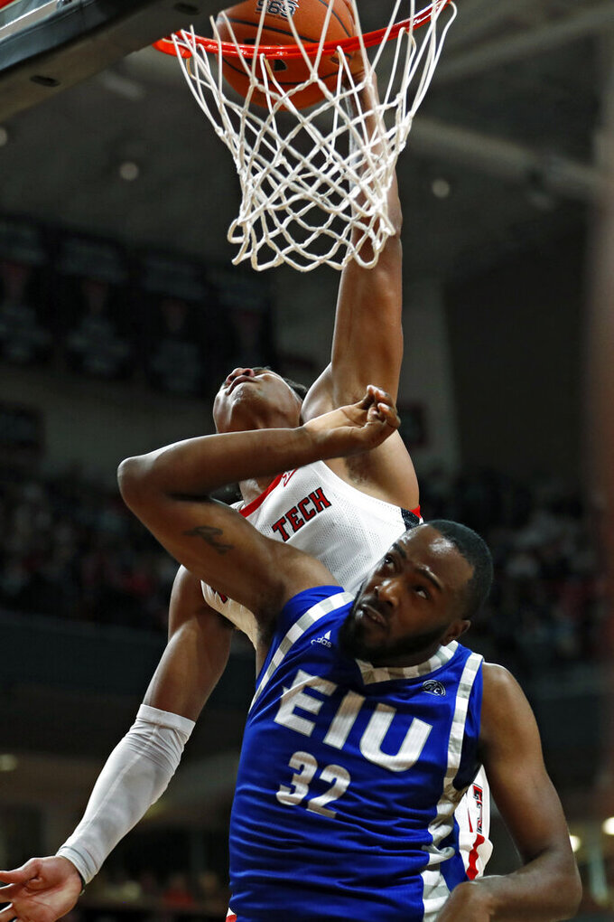 Texas Tech's Terrence Shannon, Jr. (1) dunks the ball over over Eastern Illinois' JaQualis Matlock (32) during the first half of an NCAA college basketball game Tuesday, Nov. 5, 2019, in Lubbock, Texas. (AP Photo/Brad Tollefson)