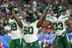 New York Jets defensive tackle Michael Dwumfour (50) celebrates after recovering a fumble in the first half of an NFL preseason football game against the New York Giants, Saturday, Aug. 14, 2021, in East Rutherford, N.J. (AP Photo/Frank Franklin II)