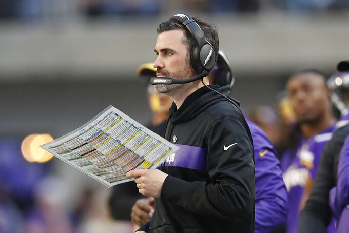 FILE - In this Dec. 16, 2018, file photo, Minnesota Vikings interim offensive coordinator Kevin Stefanski watches from the sideline during the first half of an NFL football game against the Miami Dolphins, in Minneapolis. It's Kevin Stefanski's turn to try and fix the broken Browns. The Vikings offensive coordinator was officially hired by Cleveland on Monday, Jan. 13, 2020,  as the 18th full-time coach in franchise history and 10th since the Browns' expansion return, which to this point has been a resounding two-decade debacle. (AP Photo/Jeff Haynes, File)