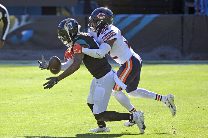 Jacksonville Jaguars wide receiver DJ Chark Jr., left, makes a reception in front of Chicago Bears cornerback Kindle Vildor during the first half of an NFL football game, Sunday, Dec. 27, 2020, in Jacksonville, Fla. (AP Photo/Phelan M. Ebenhack)