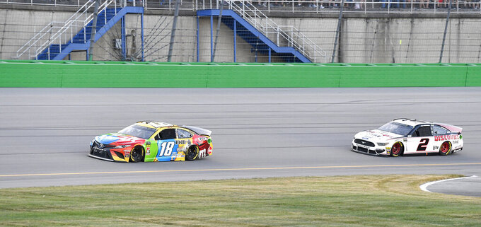 Kyle Busch (18) drives in front of Brad Keselowski (2) into Turn 1 during the NASCAR Cup Series auto race at Kentucky Speedway in Sparta, Ky., Saturday, July 13, 2019. (AP Photo/Timothy D. Easley)