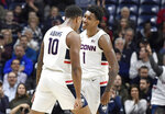 Connecticut's Brendan Adams (10) celebrates with Christian Vital (1) in the first half of an NCAA college basketball game against Temple, Wednesday, Jan. 29, 2020, in Storrs, Conn. (AP Photo/Jessica Hill)