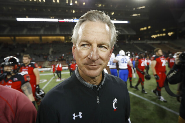 "FILE - In this Nov. 18, 2016 file photo, Cincinnati coach Tommy Tuberville walks off the field after the team's NCAA college football game against Memphis in Cincinnati. Democratic Sen. Doug Jones of Alabama has called Republican challenger Tommy Tuberville ""Coach Clueless"" for the former football coach's recent comments about the coronavirus. Jones attacked Tuberville in a campaign appearance Friday, Sept. 11, 2020. (AP Photo/John Minchillo, File)"