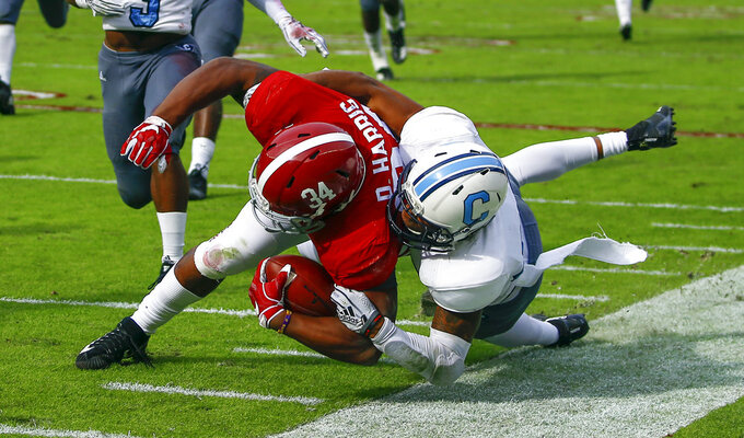 Alabama running back Damien Harris (34) is injured as he is tackled by Citadel defensive back Ronald Peterkin (33) during the second half of an NCAA college football game, Saturday, Nov. 17, 2018, in Tuscaloosa, Ala. (AP Photo/Butch Dill)