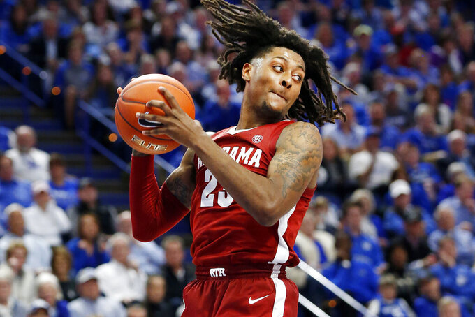 Alabama's John Petty Jr. pulls down a rebound during the second half of an NCAA college basketball game against Kentucky in Lexington, Ky., Saturday, Jan 11, 2020. Kentucky on 76-67. (AP Photo/James Crisp)