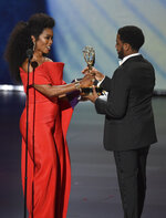 Angela Bassett , left, presents Jharrel Jerome with the award for outstanding lead actor in a limited series or movie for