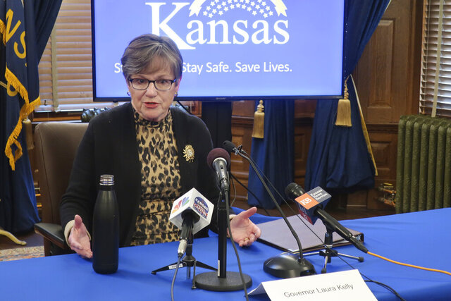 In this photo taken Wednesday, April 15, 2020, Kansas Gov. Laura Kelly answers questions about the coronavirus pandemic, during a news conference at the Statehouse in Topeka, Kan. Kelly faces a federal lawsuit filed by two churches and their pastors over an order she issued limiting religious gatherings to 10 or fewer congregation members. (AP Photo/John Hanna)