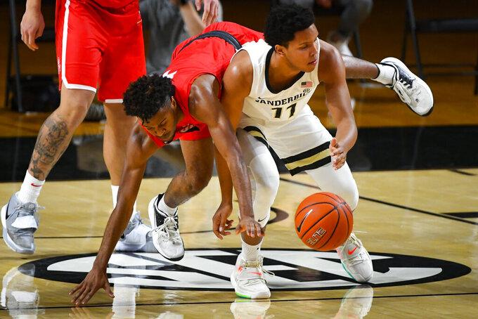 Radford guard Josiah Jeffers, left, tries to get the ball from Vanderbilt guard Braelee Albert, during the first half of an NCAA college basketball game Saturday, Dec. 19, 2020, in Nashville, Tenn. (AP Photo/John Amis)