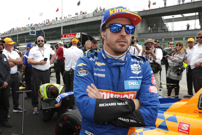 FILE - In this file photo dated Sunday, May 19, 2019, Fernando Alonso, of Spain, prepares to drive during qualifications for the Indianapolis 500 IndyCar auto race at Indianapolis Motor Speedway, in Indianapolis, Ind. Fernando Alonso feels far better about his chances to close out motorsports' version of the Triple Crown in 2020. The Spaniard will race for Arrow McLaren SP in the Indianapolis 500 in May and believes the organization is prepared. (AP Photo/Michael Conroy, File)