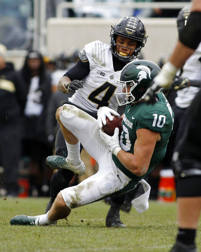 Michigan State's Matt Morrissey (10) intercepts a pass intended for Purdue's Rondale Moore (4) in the closing minutes of the fourth quarter of an NCAA college football game, Saturday, Oct. 27, 2018, in East Lansing, Mich. Michigan State won 23-13. (AP Photo/Al Goldis)