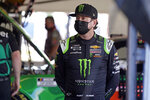 Kurt Busch waits in his garage before the start of a NASCAR Daytona 500 auto race practice session at Daytona International Speedway, Wednesday, Feb. 10, 2021, in Daytona Beach, Fla. (AP Photo/John Raoux)