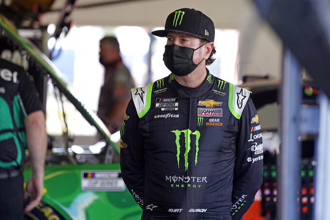 Kurt Busch waits in his garage before the start of a NASCAR Daytona 500 auto race practice session at Daytona International Speedway, Wednesday, Feb. 10, 2021, in Daytona Beach, Fla. (AP Photo/John Raoux)