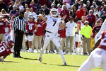 Mississippi State quarterback Tommy Stevens throws a touchdown pass against Arkansas during the first half of an NCAA college football game, Saturday, Nov. 2, 2019 in Fayetteville, Ark. (AP Photo/Michael Woods)